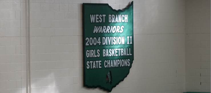 West Branch Warriors 2004 Division II Girls Basketball State Champions Plaque in Gym