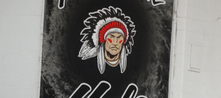 Carrollton Warrior Logo Black Hole Banner in Gym