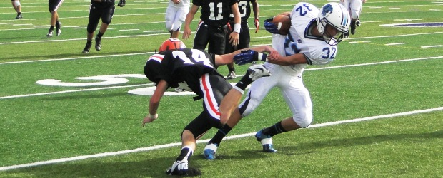 Kyle Woost Breaks a Zach Johnson Tackle in the JV Louisville Hoover 2012 Football Game